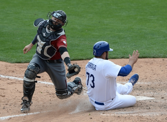 Los Angeles Dodgers Shawn Zarraga is safe at home during game against the Arizona Diamondbacks  Saturday, March 5, 2016 at Camelback Ranch-Glendale in Phoenix, Arizona.
