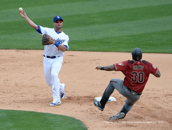 Los Angeles Dodgers Brandon Hicks turns double play during game against the Arizona Diamondbacks  Saturday, March 5, 2016 at Camelback Ranch-Glendale in Phoenix, Arizona.