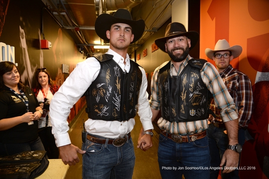 Los Angeles Dodgers Chase De Jong and Chris Hatcher dawn the gear during visit to Professional Bull Riders event Saturday, March 5, 2016 at Talking Stick Arena