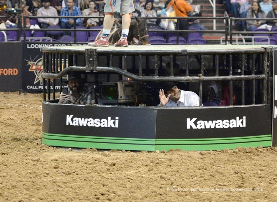 Los Angeles Dodgers Chris Hatcher and Chase De Jong watch from the center of the arena during visit to the Professional Bull Riders event Saturday, March 5, 2016 at Talking Stick Arena