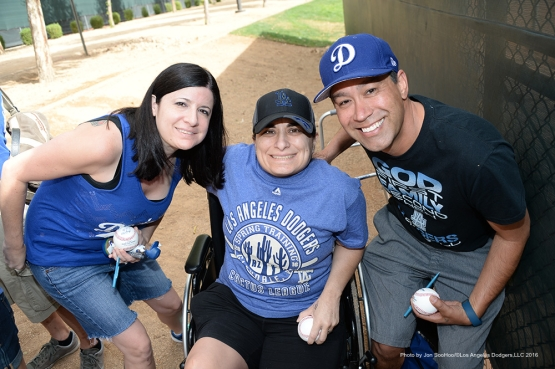 GREAT Los Angeles Dodger fans pose during morning workout Sunday, March 6, 2016 at Camelback Ranch-Glendale in Phoenix, Arizona.