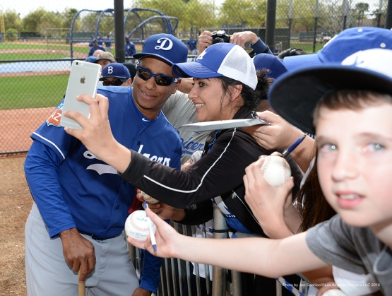 Los Angeles Dodgers Jose Vizcaino poses with fan during morning workout Sunday, March 6, 2016 at Camelback Ranch-Glendale in Phoenix, Arizona.