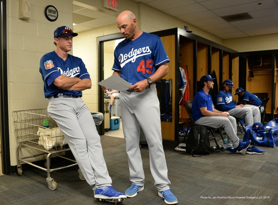 Los Angeles Dodgers Chase Utley and Chris Woodward talk prior to  game against the San Francisco Giants Sunday, March 6, 2016 at Scottsdale Stadium in Scottsdale, Arizona.