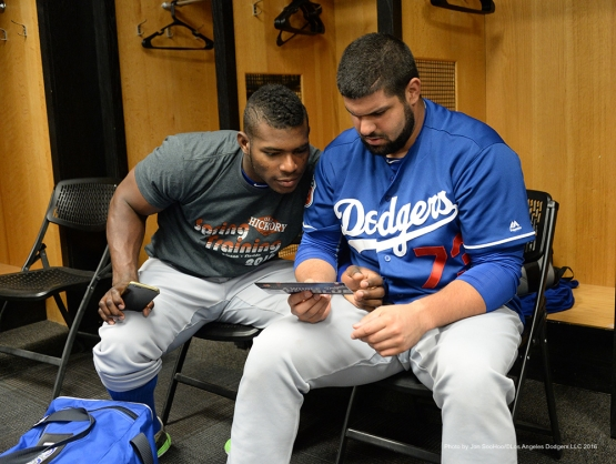 Los Angeles Dodgers Yasiel Puig and Shawn Zarraga talk prior to  game against the San Francisco Giants Sunday, March 6, 2016 at Scottsdale Stadium in Scottsdale, Arizona.