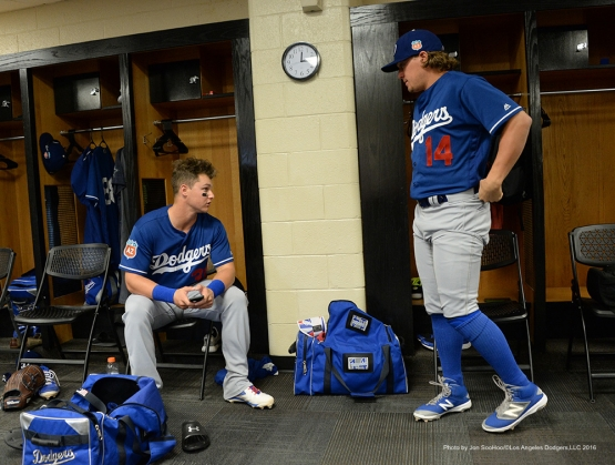 Los Angeles Dodgers Joc Pederson and Kike Hernandez talk prior to the game against the San Francisco Giants Sunday, March 6, 2016 at Scottsdale Stadium in Scottsdale, Arizona.