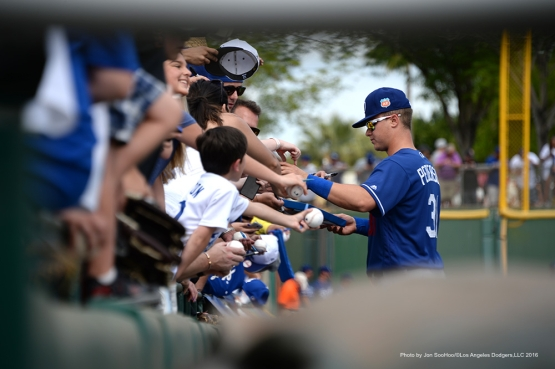 Los Angeles Dodger Joc Pederson signs for fans prior to game against the San Francisco Giants Sunday, March 6, 2016 at Scottsdale Stadium in Scottsdale, Arizona.