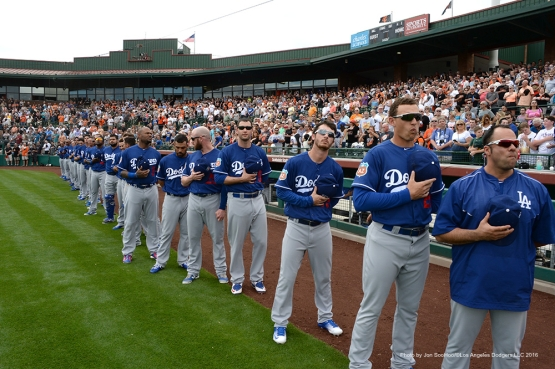 Los Angeles Dodgers line up for the anthem prior to game against the San Francisco Giants Sunday, March 6, 2016 at Scottsdale Stadium in Scottsdale, Arizona.