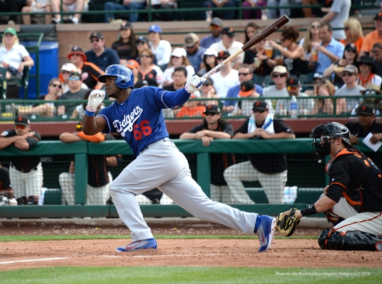Los Angeles Dodger Yasiel Puig gets a hit during game against the San Francisco Giants Sunday, March 6, 2016 at Scottsdale Stadium in Scottsdale, Arizona.