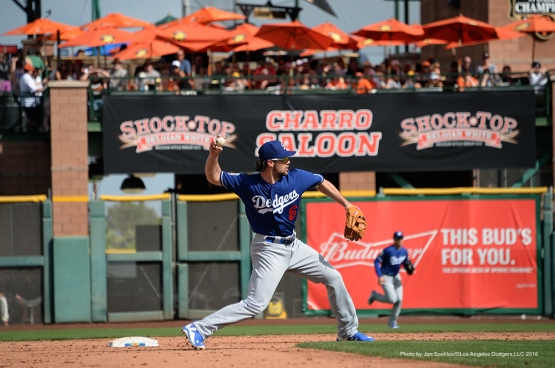 Los Angeles Dodger Charlie Culbertson throws to first during game against the San Francisco Giants Sunday, March 6, 2016 at Scottsdale Stadium in Scottsdale, Arizona.