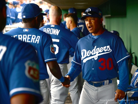 Los Angeles Dodgers Dave Roberts shakes Elian Herrera's hand during game against the San Francisco Giants Sunday, March 6, 2016 at Scottsdale Stadium in Scottsdale, Arizona.