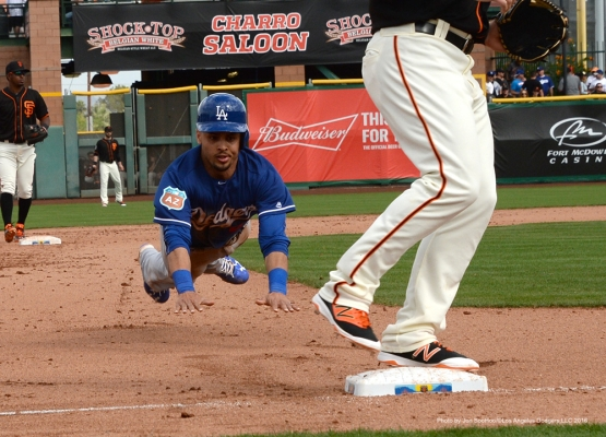 Los Angeles Dodgers Rico Noel dives safely into third during game against the San Francisco Giants Sunday, March 6, 2016 at Scottsdale Stadium in Scottsdale, Arizona.