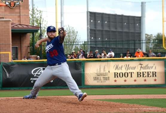 Los Angeles Dodgers Logan Bawcom pitches the ninth against the San Francisco Giants Sunday, March 6, 2016 at Scottsdale Stadium in Scottsdale, Arizona.