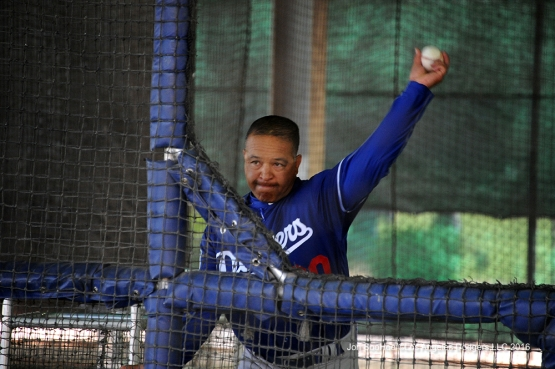 Dave Roberts throws during workout Friday, March 18, 2016 at Camelback Ranch-Glendale in Phoenix, Arizona.