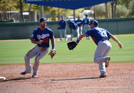 Los Angeles Dodgers Austin Barnes lobs to Brandon Hicks during workout Saturday, March 19,2016 at Camelback Ranch-Glendale in Phoenix, Arizona.