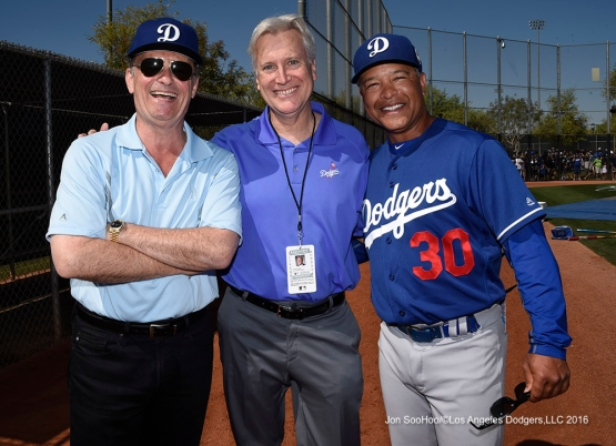 Los Angeles Dodgers Stan Kasten, Mark Walter and Dave Roberts during workout Saturday, March 19,2016 at Camelback Ranch-Glendale in Phoenix, Arizona.