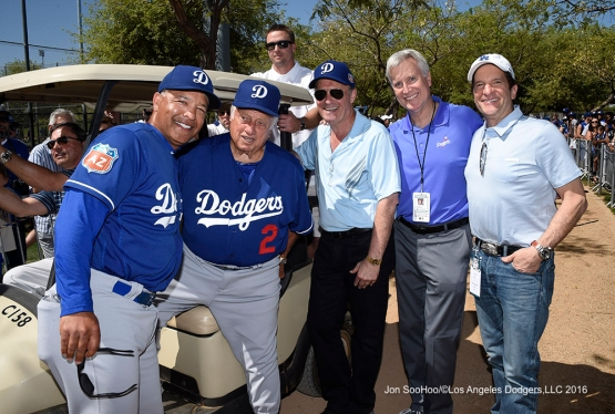 Los Angeles Dodgers Dave Roberts, Tommy Lasorda, Stan Kasten, Mark Walter and Peter Guber during workout Saturday, March 19,2016 at Camelback Ranch-Glendale in Phoenix, Arizona.
