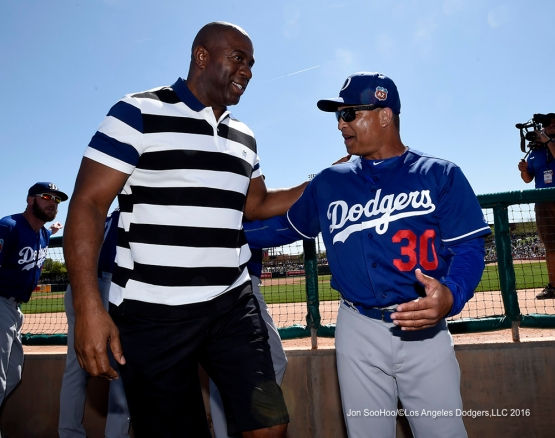 "Los Angeles Dodgers Earvin ""Magic"" Johnson and Dave Roberts during game against the Chicago White Sox Saturday, March 19,2016 at Camelback Ranch-Glendale in Phoenix, Arizona."
