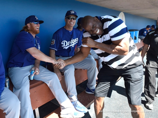 Los Angeles Dodgers Justin Turner and Magic Johnson share a laugh during game against the Chicago White Sox Saturday, March 19,2016 at Camelback Ranch-Glendale in Phoenix, Arizona.
