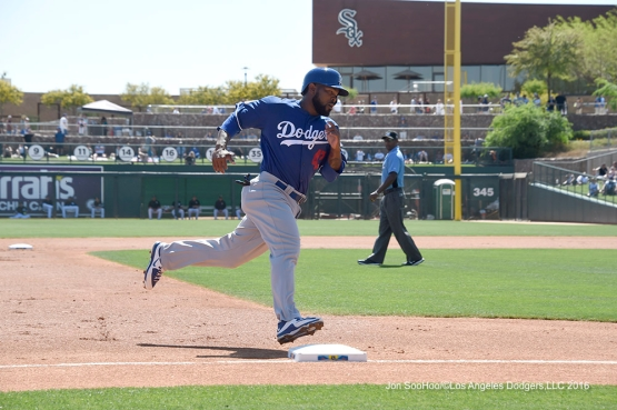 Los Angeles Dodgers Howie Kendrick rounds third during game against the Chicago White Sox Saturday, March 19,2016 at Camelback Ranch-Glendale in Phoenix, Arizona.