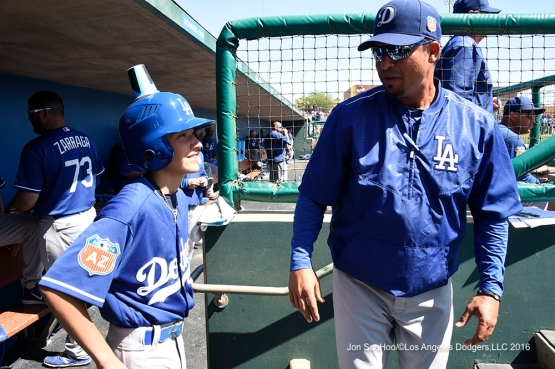 Los Angeles Dodgers Juan Castro and batboy during game against the Chicago White Sox Saturday, March 19,2016 at Camelback Ranch-Glendale in Phoenix, Arizona.