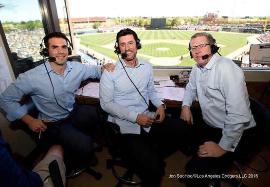 SportsNet LA-Los Angeles Dodgers broadcaster Joe Davis, Nomar Garciaparra and Orel Hershiser during game against the Chicago White Sox Saturday, March 19,2016 at Camelback Ranch-Glendale in Phoenix, Arizona.