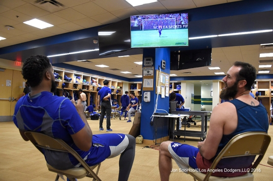 Los Angeles Dodgers Scott Van Slyke beats Kenley Jansen prior to workout Sunday, March 20, 2016 at Camelback Ranch-Glendale in Phoenix, Arizona.