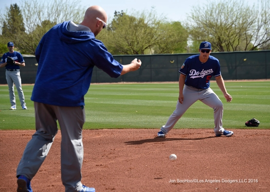 Los Angeles Dodgers Cory Seager goes through drills with Brandon McDaniel during workout Sunday, March 20, 2016 at Camelback Ranch-Glendale in Phoenix, Arizona.