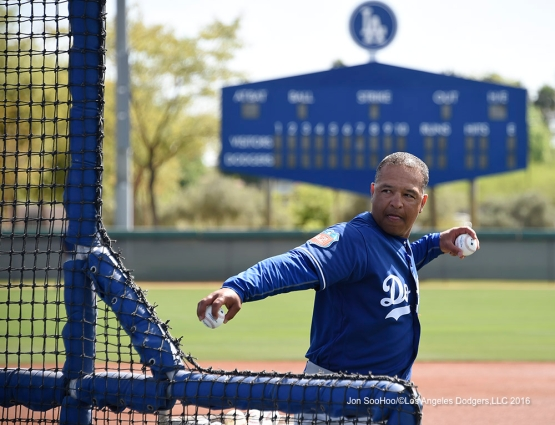 Los Angeles Dodgers Dave Roberts throws batting practice during workout Sunday, March 20, 2016 at Camelback Ranch-Glendale in Phoenix, Arizona.
