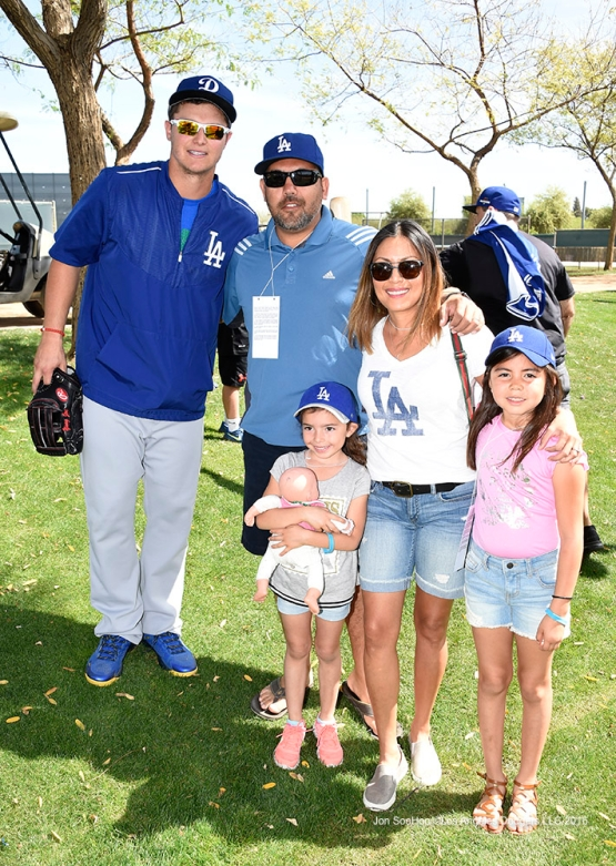 Los Angeles Dodgers Joc Pederson poses with great Dodger fans during workout Sunday, March 20, 2016 at Camelback Ranch-Glendale in Phoenix, Arizona.
