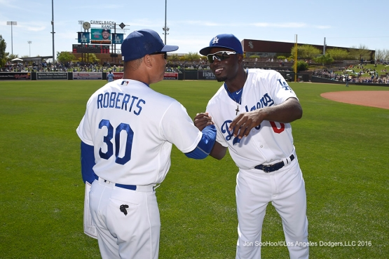 Los Angeles Dodgers Dave Roberts with minor leaguer Devan Ahart during game against the San Diego Padres Sunday, March 20, 2016 at Camelback Ranch-Glendale in Phoenix, Arizona.