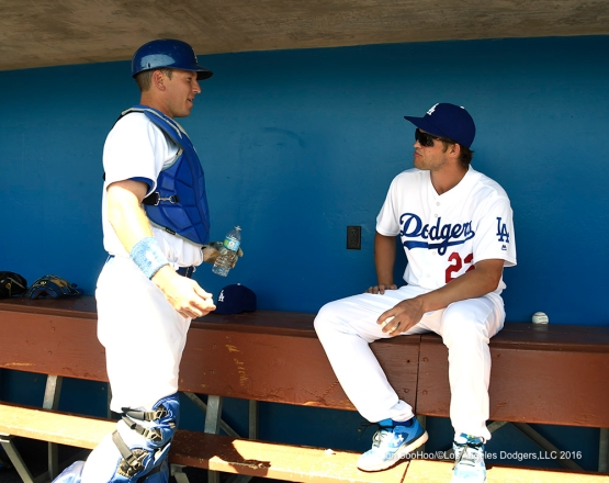 Los Angeles Dodgers A.J. Ellis and Clayton Kershaw during game against the San Diego Padres Sunday, March 20, 2016 at Camelback Ranch-Glendale in Phoenix, Arizona.