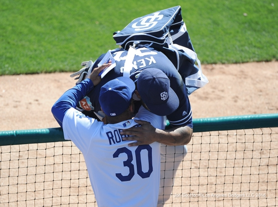Los Angeles Dodgers Dave Roberts gets a hug from Matt Kemp during game against the San Diego Padres Sunday, March 20, 2016 at Camelback Ranch-Glendale in Phoenix, Arizona.