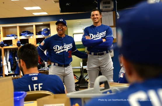 Los Angeles Dodgers Dave Roberts and Trayce Thompson laugh prior to workout Friday, March 4, 2016 at Camelback Ranch-Glendale in Phoenix, Arizona.