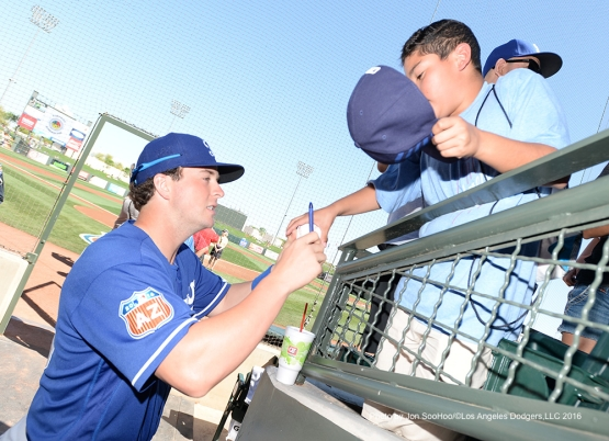Los Angeles Dodgers Matt West signs for fan prior to game against the Texas Rangers Friday, March 4, 2016 at Surprise Recreation Campus in Surprise, Arizona.