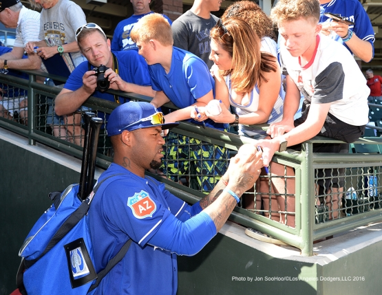 Los Angeles Dodgers Carl Crawford signs for fans prior to game against the Texas Rangers Friday, March 4, 2016 at Surprise Recreation Campus in Surprise, Arizona.