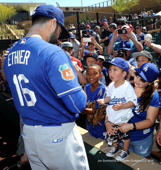 Los Angeles Dodgers Andre Ethier signs for fan prior to game against the Arizona Diamondback Friday, March 18,2016 at Salt River Fields at Talking Stick