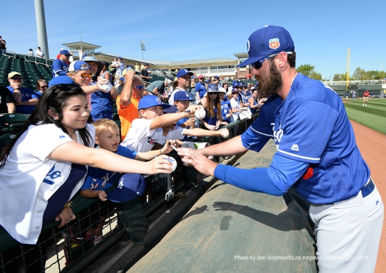 Los Angeles Dodgers Scott Van Slyke signs for fans prior to game against the Texas Rangers Friday, March 4, 2016 at Surprise Recreation Campus in Surprise, Arizona.