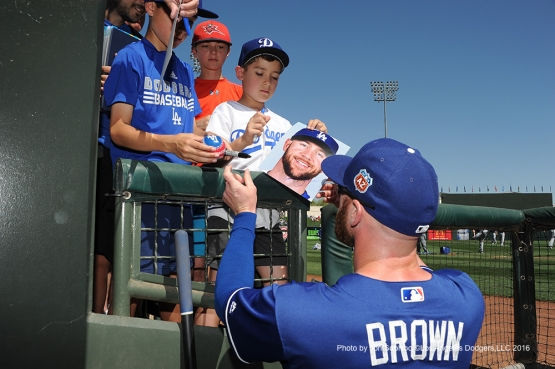 Los Angeles Dodgers Corey Brown signs for a fan prior to game against the Texas Rangers Friday, March 4, 2016 at Surprise Recreation Campus in Surprise, Arizona.