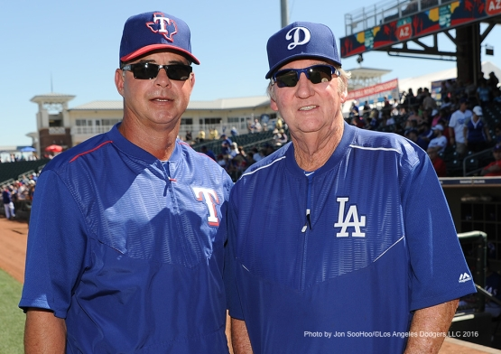 Dodgers coach Charlie Hough poses with former teammate, Texas Rangers Geno Petralli (L) Friday, March 4, 2016 at Surprise Recreation Campus in Surprise, Arizona.