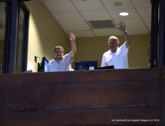 Los Angeles Dodgers Charley Steiner and Rick Monday wave to the crowd during game against the San Francisco Giants Friday, March 25, 2016 at Camelback Ranch-Glendale in Phoenix, Arizona