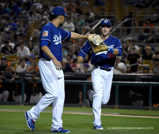 Los Angeles Dodgers Carlos Frias and Chase Utley during game against the San Francisco Giants Friday, March 25, 2016 at Camelback Ranch-Glendale in Phoenix, Arizona