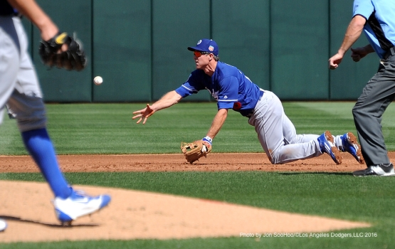 Los Angeles Dodgers Chase Utley starts the double play against the Texas Rangers Friday, March 4, 2016 at Surprise Recreation Campus in Surprise, Arizona.