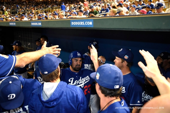 Los Angeles Dodgers Adrian Gonzalez greeted in the dugout after scoring in the first during game against the San Francisco Giants Friday, March 25, 2016 at Camelback Ranch-Glendale in Phoenix, Arizona