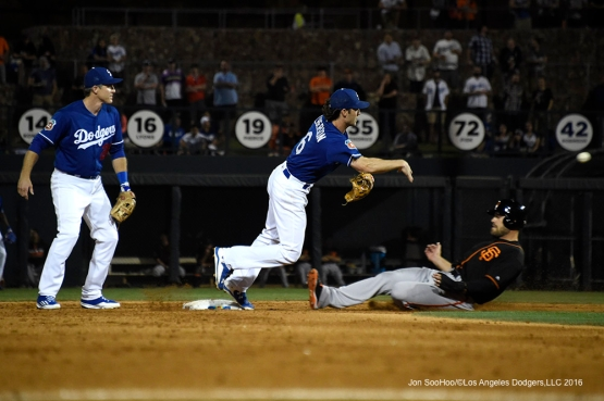 Los Angeles Dodgers Charlie Culbertson throws to first during game against the San Francisco Giants Friday, March 25, 2016 at Camelback Ranch-Glendale in Phoenix, Arizona