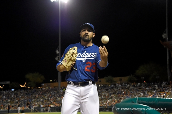 Los Angeles Dodgers Adrian Gonzalez with a gift for a fan during game against the San Francisco Giants Friday, March 25, 2016 at Camelback Ranch-Glendale in Phoenix, Arizona