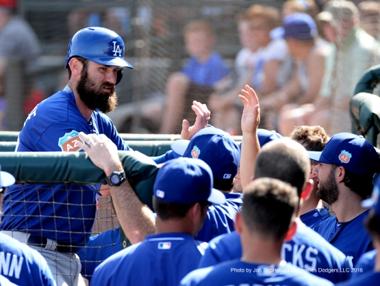 Los Angeles Dodgers Scott Van Slyke is greeted in the dugout by teammates after two run homer against the Texas Rangers Friday, March 4, 2016 at Surprise Recreation Campus in Surprise, Arizona.