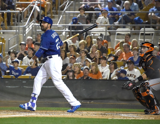 Los Angeles Dodgers Adrian Gonzalez homers to left during game against the San Francisco Giants Friday, March 25, 2016 at Camelback Ranch-Glendale in Phoenix, Arizona