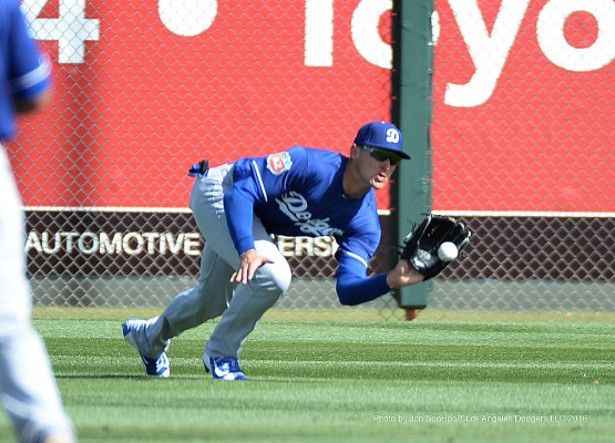 Los Angeles Dodgers Trayce Thompson catches ball against the Texas Rangers Friday, March 4, 2016 at Surprise Recreation Campus in Surprise, Arizona.