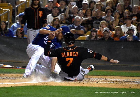 Los Angeles Dodgers Carlos Frias makes the tag at home during game against the San Francisco Giants Friday, March 25, 2016 at Camelback Ranch-Glendale in Phoenix, Arizona
