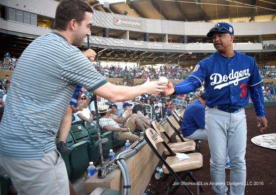 Los Angeles Dodgers Dave Roberts gives away ball during game against the Arizona Diamondback Friday, March 18,2016 at Salt River Fields at Talking Stick